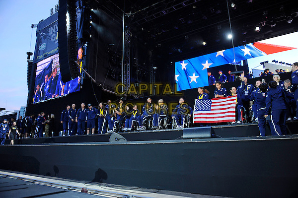 LONDON, ENGLAND - SEPTEMBER 14:  Team USA receive their medals at The Jaguar Land Rover Invictus Games Closing Concert at Queen Elizabeth Olympic Park on September 14, 2014 in London, England.<br /> CAP/MAR<br /> &copy; Martin Harris/Capital Pictures