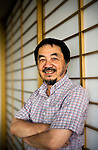 "Tetsu Kariya, writer of the best-selling manga series ""Oishinbo"", poses for a photo at his home in Kanagawa, Japan on 28 Sept. 2009..Photographer: Robert Gilhooly"