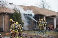 STAFF PHOTO ANTHONY REYES &bull; @NWATONYR<br /> Springdale firefighters put out hot spots at a house fire Wednesday, Dec. 24, 2014 at 1503 Thrush Street in Springdale. There were no injuries in the fire which the owner thinks started near his space heater. The duplex owned by Marc Miller lived in the damaged unit. Firefighter got the call for the blaze at 12:30 p.m. and the fire was under control within 20 minutes. Four dogs were in the building, three are safe and one was missing as of press time.