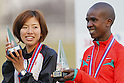 (L to R) Hitomi Niiya (JPN),   Mokua Edwin Nyandusi (KEN), NOVEMBER 23, 2011 - Ekiden : Hitomi Niiya of Japan and Mokua Edwin Nyandusi of kenya pose with MVP Trophy during the Hanji Aoki Cup 2011 International Chiba Ekiden race in Chiba, Japan.  (Photo by Yusuke Nakanishi/AFLO SPORT) [1090]