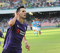 Fiorentina's Nikola Kalinic  celebrates after scoring during the Italian Serie A soccer match between SSC Napoli and AC Fiorentina  at San Paolo stadium in Naples,October 18, 2015
