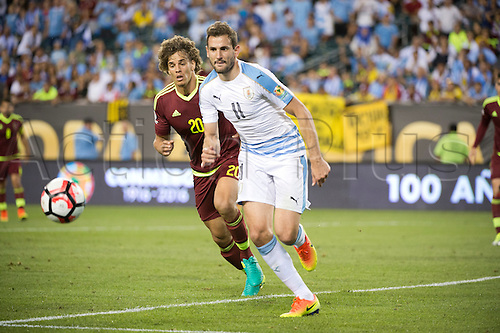 June 9, 2016: Uruguay Forward Cristhian Stuani (11) and Venezuela Defender Rolf Feltscher (20) chase the ball in the second half during the Group A game between Uruguay and Venezuela at Lincoln Financial Field in Philadelphia, PA (Photo by Kyle Ross/Icon Sportswire)