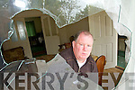 ATTACK: Michael O'Brien pictured on Tuesday 15th July examining a damaged window following an attack on his home in Ardfert.   Copyright Kerry's Eye 2008