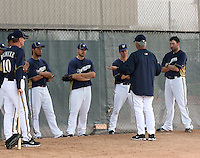 Manager Ron Roenike #10, pitcher Yovani Gallardo #49, pitcher Mark Rogers #37, pitcher Zack Greinke #13, pitching coach Rick Kranitz #39 (back to the camera) and pitcher Shaun Marcum #18 discuss pitching strategy during spring training workouts at the Brewers complex on February 18, 2011  in Phoenix, Arizona. .Photo by Bill Mitchell / Four Seam Images.