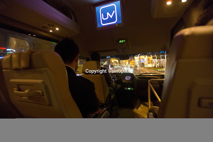 A bus picks up diners and  drops them off at the Ultraviolet restaurant in Shanghai, China on 27th Sept 2013.  The restaurant in run by Chef Paul Pairet. <br /> <br /> Photo by Qilai Shen / Sinopix