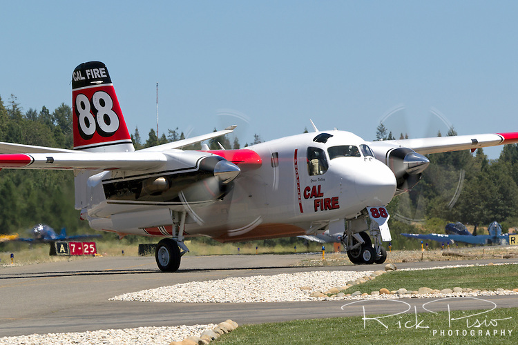 Calfire Grumman S2-T Turbo Tracker taxis at the Grass Valley Air Attack Base. The Turbo Tracker is a civilian conversion of the Navy's S-2 Tracker. The Calfire fleet, formerly California Department of Forestry, includes 23 of the Turbo Trackers located throughout the state. Each aircraft is capable of carrying 1200 gallons of water or retardant and able to reach a fire within 20 minutes.