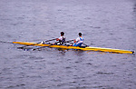 Two competitive rowers practicing on flat water