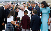 United States President Barack Obama and First Lady Michelle Obama greet His Holiness Pope Francis on his arrival at Joint Base Andrews in Maryland on September 22, 2015. The Pope is making his first trip to the United States on a three-city, five-day tour that will include Washington, D.C., New York City and Philadelphia. <br /> Credit: Olivier Douliery / Pool via CNP