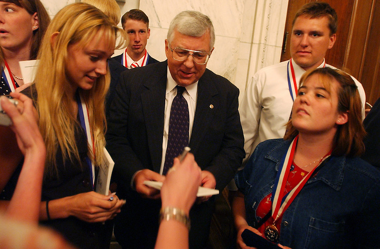 medal1/062503 - Sen. Mike Enzi, R-Wyo., signs autographs for winners of the Congressional Award Gold Medal, including Jacquelyn Bell, at left, 19, of Gillette, Wyoming, who helped start a 4-H Club in her town.  The Medal is the highest honor bestowed upon young people by the U.S. Congress.