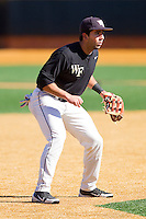 Third baseman Carlos Lopez #3 of the Wake Forest Demon Deacons on defense during an intrasquad game at Wake Forest Baseball Park on January 29, 2012 in Winston-Salem, North Carolina.  (Brian Westerholt / Four Seam Images)