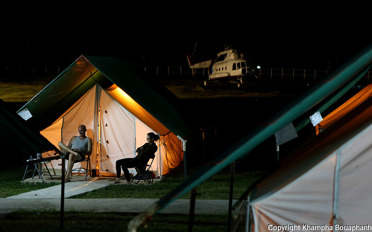 Sgt. Jason Tinker and Staff Sgt. Lauren Shaw hang out at base camp after a day of work at a dig site, searching for remains of missing American military from the Vietnam war at Ta Oy, Laos on Tuesday, November 6, 2012. (Star-Telegram/Khampha Bouaphanh)