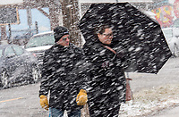 An umbrella is usually used for protection from rain, but it's also a great shield from wet blowing snow. Sarnia residents Leo Paquette and Pauline Janzen head for home during a wet, snowy day recently. The pair were downtown shopping and exploring the bakery.