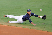 4 March 2009:  FIU's Ryan Mollica (7) dives for a ball in the first inning of the FIU 8-3 victory over the University of Central Florida  at University Park Stadium in Miami, Florida.
