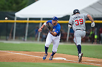 Brandon Dulin (31) of the Burlington Royals waits for a throw as Jeff Campbell (39) of the Danville Braves hustles down the first base line at Burlington Athletic Park on July 12, 2015 in Burlington, North Carolina.  The Royals defeated the Braves 9-3. (Brian Westerholt/Four Seam Images)