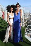 Models Kris-Anne (left) and Kalah pose in outfits from the Carlton Jones Resort 2017 collection fashion show at Le Bain in The Standard Hotel in New York City, on June 8, 2017.