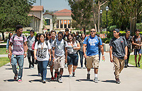 Upward Bound students make their way across the Oxy campus between classes. The summer program offers an intensive and social way for participants to get a leg up on life. The program is for high school students who have an interest in attending college when they graduate, helping them navigate problems big and small. Photo taken on June 23, 2015 for an Occidental Magazine article.<br />