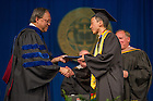 May 18, 2014; Peter Woo receives his diploma from Mendoza College of Business Dean Roger Huang at the 2014 Commencement Ceremony.<br /> <br /> Photo by Matt Cashore/University of Notre Dame