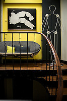 Yellow and black predominate at the top of the elegantly curving stairs