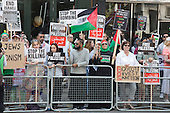 London, UK. 26 July 2014. Protesters gathered near the Israeli Embassy in Kensington High Street, London, ahead of a march to Parliament Square to call for an end to the Israeli military action against the Palestinians in the Gaza Strip.