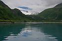 July 17 thru 23 / Alaska / Vacation and stock photography / Whittier Glacier as scene across Portage Lake / Photo by Bob Laramie