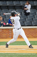 Will Craig (22) of the Wake Forest Demon Deacons follows through on his swing against the Maryland Terrapins at Wake Forest Baseball Park on April 4, 2014 in Winston-Salem, North Carolina.  The Demon Deacons defeated the Terrapins 6-4.  (Brian Westerholt/Four Seam Images)
