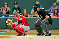 California League All-Star catcher John Hicks #8 of the High Desert Mavericks warms up his pitcher as home plate umpire John Bacon looks on during the 2012 California-Carolina League All-Star Game at BB&T Ballpark on June 19, 2012 in Winston-Salem, North Carolina.  The Carolina League defeated the California League 9-1.  (Brian Westerholt/Four Seam Images)