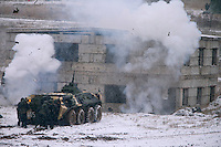 Krasnoarmeysk, Moscow Region, Russia, 29/10/2010..Grenades explode as Russian special forces use an armoured personnel carrier to storm a building during a training exercise at a military base outside Moscow. The exercise was part of the Interpolitex 2010 state security exhibition.