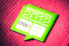 Green Innsbruck 2012 Youth Olympic Games badge on red fabric.