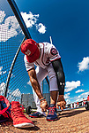 22 February 2019: Washington Nationals outfielder Juan Soto laces up prior to a Spring Training workout at the Ballpark of the Palm Beaches in West Palm Beach, Florida. Mandatory Credit: Ed Wolfstein Photo *** RAW (NEF) Image File Available ***