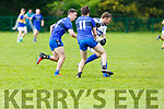 Cordal keeper Sean Óg O'Ciardubhain heading outfield as Renard's Michael O'Leary and Jim Sugrue bear down on him, in the Junior Club Football Championship semi final in Beaufort on Sunday.