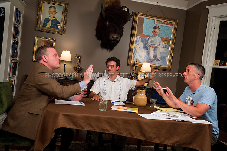 "8/15/2012--Seattle, WA, USA..A ""dining room debate"" between author, activist and sex advice columnist Dan Savage and National Organization for Marriage (NOM) president Brian Brown over same sex marriage...Here: Savage (right), Brown (left), and Mark Oppenheimer (center) during the debate...After Savage criticized Christians and their interpretation of the Bible in a speech given at a Catholic high school, NOM president Brian Brown responded on Twitter by telling Savage to pick on someone his own size, and challenged him to a debate ""any time, anywhere"". So Savage invited Brown to debate in his Seattle home, where Savage was joined by his husband Terry Miller and their adopted son D.J. The debate was moderated by reporter Mark Oppenheimer...©2012 Stuart Isett. All rights reserved."