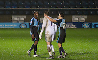 Goalkeeper Matt Ingram of Wycombe Wanderers is consoled after a harsh red card during the Sky Bet League 2 match between Wycombe Wanderers and Morecambe at Adams Park, High Wycombe, England on 2 January 2016. Photo by Kevin Prescod / PRiME Media Images