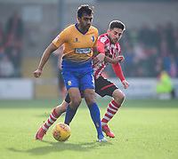 Mansfield Town's Malvind Benning shields the ball from Lincoln City's Tom Pett<br /> <br /> Photographer Chris Vaughan/CameraSport<br /> <br /> The EFL Sky Bet League Two - Lincoln City v Mansfield Town - Saturday 24th November 2018 - Sincil Bank - Lincoln<br /> <br /> World Copyright &copy; 2018 CameraSport. All rights reserved. 43 Linden Ave. Countesthorpe. Leicester. England. LE8 5PG - Tel: +44 (0) 116 277 4147 - admin@camerasport.com - www.camerasport.com