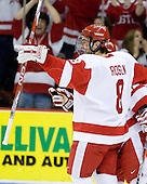 Ben Rosen (BU - 8) and Chris Connolly (BU - 12) celebrate Connolly's goal, his first of two in the game. - The Boston University Terriers defeated the Merrimack College Warriors 6-4 on Saturday, November 14, 2009, at Agganis Arena in Boston, Massachusetts.