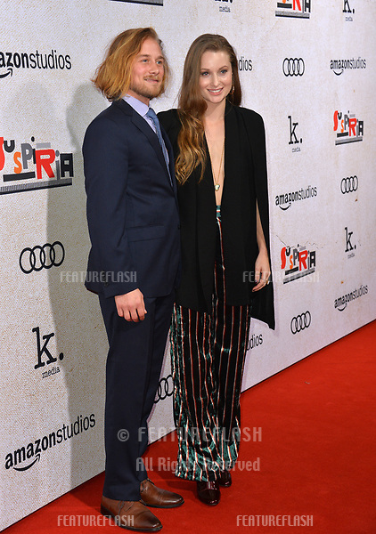 """LOS ANGELES, CA. October 24, 2018: Lou Taylor Pucci & Camille Kane at the Los Angeles premiere for """"Suspiria"""" at the Cinerama Dome.<br /> Picture: Paul Smith/Featureflash"""