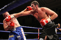Tyson Fury (Manchester, black shorts) defeats Aleksandrs Selezens (blue shorts) in a Heavyweight Boxing contest at York Hall, Bethnal Green, promoted by Hennessy Sports - 18/07/09 -