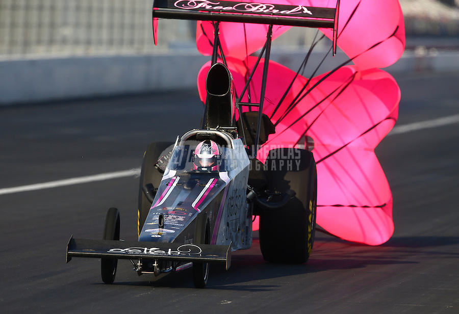 Feb 8, 2014; Pomona, CA, USA; NHRA top alcohol dragster driver Ashley Sanford during qualifying for the Winternationals at Auto Club Raceway at Pomona. Mandatory Credit: Mark J. Rebilas-