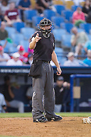 Home plate umpire Ryan Clark makes a strike call during the Eastern League game between the Akron Rubber Ducks and the Reading Fightin Phils at FirstEnergy Stadium on June 19, 2014 in Wappingers Falls, New York.  The Rubber Ducks defeated the Fightin Phils 3-2.  (Brian Westerholt/Four Seam Images)