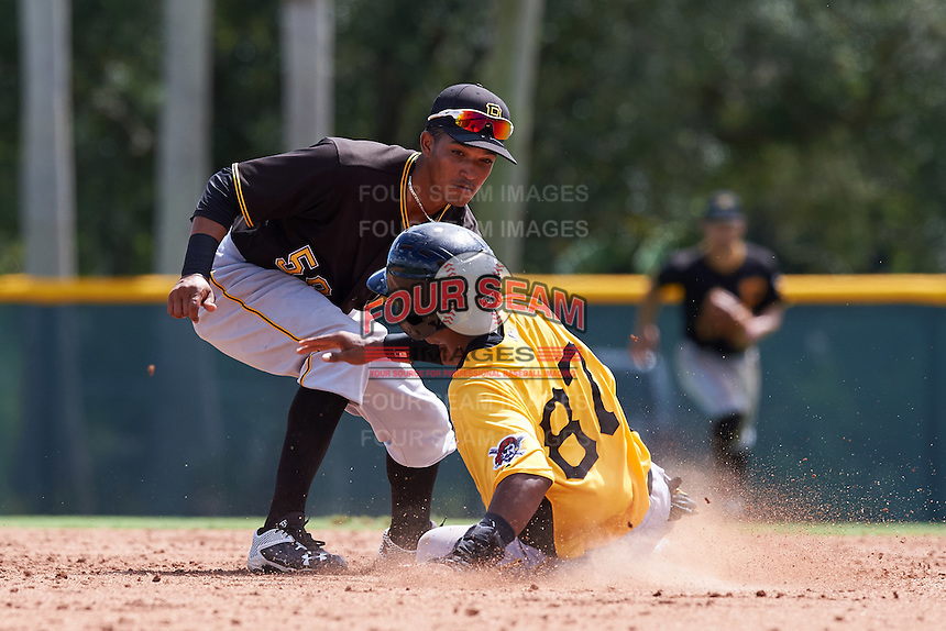 Pittsburgh Pirates shortstop Adrian Valerio (59) tags Kevin Sanchez (87) sliding into second base during an Instructional League Intrasquad Black & Gold game on September 28, 2016 at Pirate City in Bradenton, Florida.  (Mike Janes/Four Seam Images)