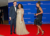 Shonda Rhimes, center, and Tony Goldwyn, left pose for photographers on the Red Carpet as they are approached by Kerry Washington, right, as they arrive for the 2016 White House Correspondents Association Annual Dinner at the Washington Hilton Hotel on Saturday, April 30, 2016.<br /> Credit: Ron Sachs / CNP<br /> (RESTRICTION: NO New York or New Jersey Newspapers or newspapers within a 75 mile radius of New York City)