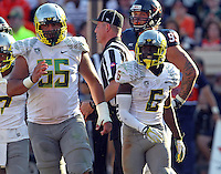 Oregon running back De'Anthony Thomas (6) Oregon offensive linesman Hroniss Grasu (55) Oregon defeated Virginia 59-10 Saturday at Scott Stadium in Charlottesville, VA. Photo/Andrew Shurtleff