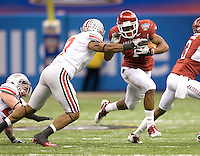 Knile Davis of Arkansas runs the ball away from Jermale Hines of Ohio State during the game during 77th Annual Allstate Sugar Bowl Classic at Louisiana Superdome in New Orleans, Louisiana on January 4th, 2011.  Ohio State defeated Arkansas, 31-26.