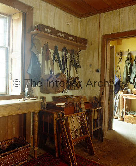 The simple entrance hall is a repository for a collection of coats, bags, hats, boots and fishing tackle