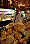 DiBruno Brothers cheese and gourmet food shop.  Cheeese seller, mod rel..Philadelphia, Pennsylvania, PA USA.  Photo copyright Lee Foster, 510-549-2202, lee@fostertravel.com, www.fostertravel.com. Photo 325-30688