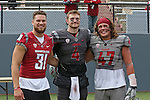 Isaac Dotson, Luke Falk and Peyton Pelluer take a timeout for a photo during the annual Washington State Cougar spring game, the Crimson and Gray game, at Joe Albi Stadium in Spokane, Washington, on April 23, 2016.