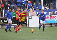 Stuart Bannigan on the ball with the advancing Nicky Low in the SPFL Ladbrokes Championship football match between Queen of the South and Partick Thistle at Palmerston Park, Dumfries on  4.5.19.