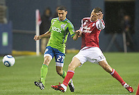 Seattle Sounder FC midfielder Lamar Neagle cannot keep the ball away from Portland Timbers midfielder Jack Jewsbury during play at Qwest Field in Seattle Saturday May 14, 2011. The game ended 1-1 draw.