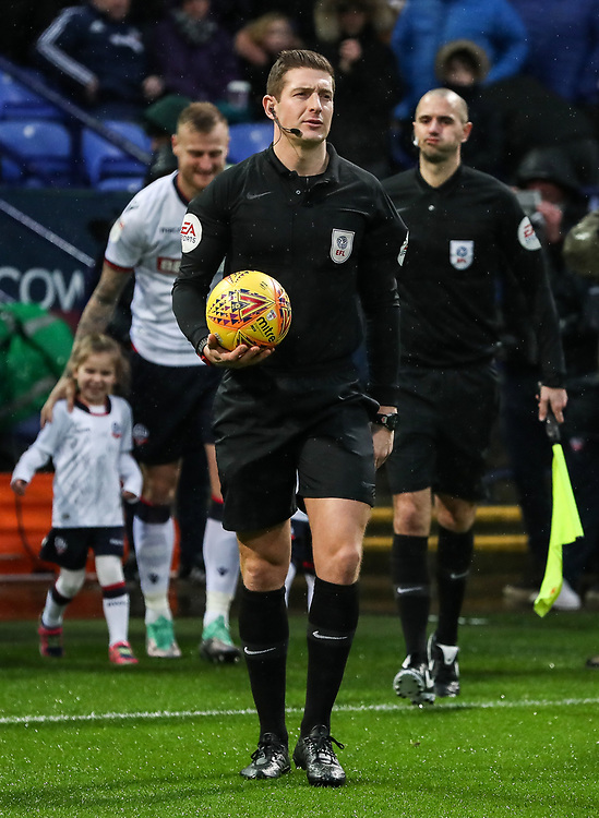 Referee Robert Jones leads the teams out<br /> <br /> Photographer Andrew Kearns/CameraSport<br /> <br /> The EFL Sky Bet Championship - Bolton Wanderers v Leeds United - Saturday 15th December 2018 - University of Bolton Stadium - Bolton<br /> <br /> World Copyright © 2018 CameraSport. All rights reserved. 43 Linden Ave. Countesthorpe. Leicester. England. LE8 5PG - Tel: +44 (0) 116 277 4147 - admin@camerasport.com - www.camerasport.com