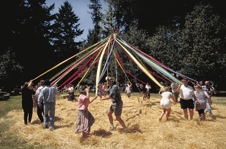 A may pole dance in the redwoods in Anderson Valley, Mendocino County California