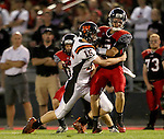 BRANDON, SD - SEPTEMBER 26: Ty Smith #15 from Washington wraps up Jake Comeaux #7 from Brandon Valley in the first quarter of their game Friday night in Brandon.  (Photo by Dave Eggen/Inertia)